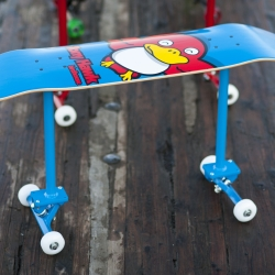 Benches made out of skateboard components.  The locked wheels function as non-marking feet, or they can easily be unlocked to roll.  Also sold as a kit to turn any standard skateboard deck into a fun little bench.