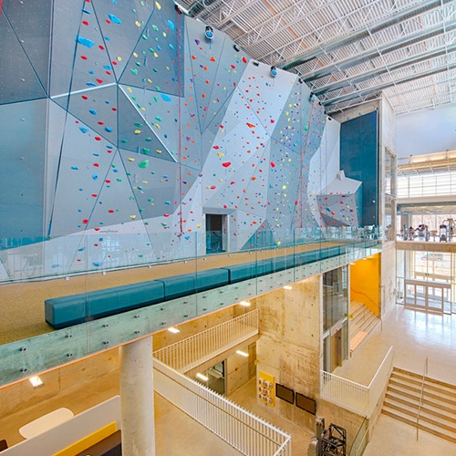 University of Manitoba Active Living Center with a 12-metre climbing wall and an elevated 200-metre indoor running track by Cibinel Architecture Ltd+ Batteriid Architects.
