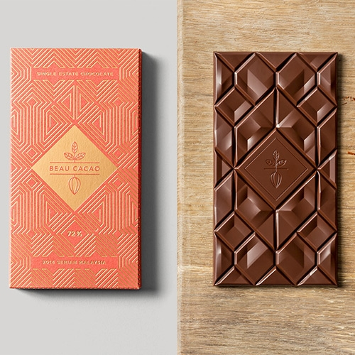 Chocolate bar and packaging design by Adam Gill and SocioDesign studio for the London-based chocolate company Beau Cacao, inspired by traditional Malaysian patterns and architectural elements.