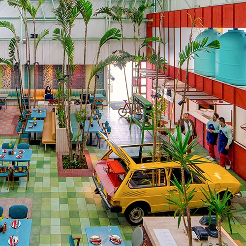 Madero Café designed by Taller KEN is a green oasis in the one of the most heavily trafficked highways in Guatemala City.