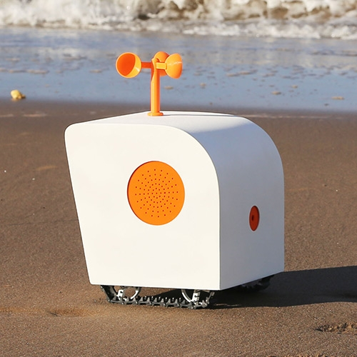 """Created by Yuxi Liu, """"Poet on the Shore"""" is a small autonomous robot that roams on the beach and writes poems in the sand."""