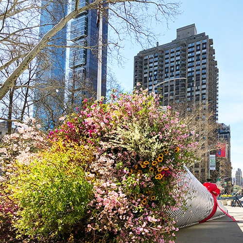 """Broadway Bouquet"" is a temporary floral installation created by Terrain Work at the intersection of Broadway and 24th Street for the NYC/DOT Car Free Earth Day event."