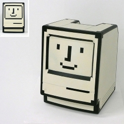 An old Mac painted to look like the old Mac happy face icon. Genius.