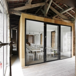 'A l'envi' restaurant in Charroux - France by Comac Architects.