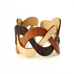 Designer Henry Wischusen uses woven bands of veneer both for their striking beauty and because thin slices are a more efficient use of a natural resource than carving away at a block of wood.