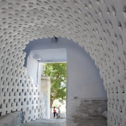 Design practice 24° Studio linked together hundreds of hollow paper stars to line a tunnel and stairway in Santorini, Greece.