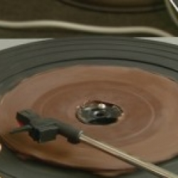 Belgian chocolatier makes a chocolate 45 rpm record! I wonder if it first stops playing or becomes to gross to eat...