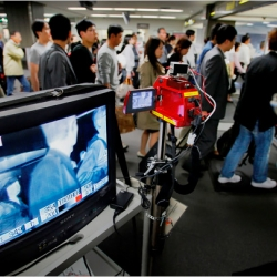 A quarantine officer monitored travelers with a thermographic device at the arrival gate at Narita International Airport, which serves Tokyo.