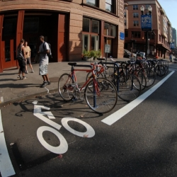 Great on-street bike parking continuing to grow in Portland, Oregon.