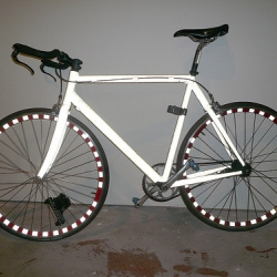 Bright Bike is a Retroreflective Vinyl coated bike. It is like coating your bike with a big sticker that turns ultra-brite in headlights.