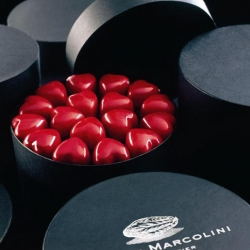 "Pierre Marcolini's vibrant and glossy red ""Coeur Framboise"". It does not get more decadent than my fav belgian choclatier's seductive hearts in their classic round gift boxes..."
