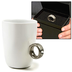 Porcelain cup with a sparkling solitaire diamond (Swarovski crystal) ring! 2-Carat Cup is packed in an elegant oversize jewelry box, so when you present it as a gift, all you see is the ring! [also seen in post #4827]