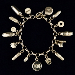 Here are some works from the Hirst's new retail store. This medicine cabinet-inspired bracelet contains 17 charms from cast pills. Each of the charms is notched and identified with clinical precision, screaming in pharmaceutical details.