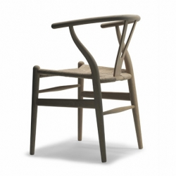 Hans Wegners classical Y-chair in a limited edition with soaped wood and and knitted natural fibres on seating. A classical piece of furniture that never go out of style. Denmark rules!