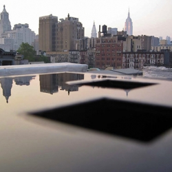 The final version of Michael Arad's 9/11 memorial features two sunken pools in the footprints of the twin towers, bisected by Snohetta's 9/11 museum entrance.