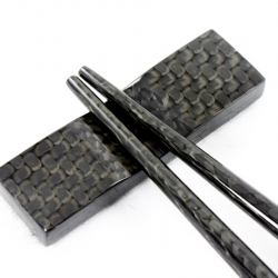 Carbon fiber chopsticks made literally out of a solid piece of carbon fiber.  Because of the grade of carbon used, it allows for a non-toxic food/dishwasher safe coating to be applied at 400 degrees.