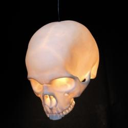 Alex Garnett's 'goliath' pendant skull lamps are made of bone china
