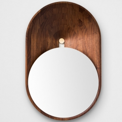 'Mono' a small miror who's play with gravity by French designer Grégoire de Lafforest.