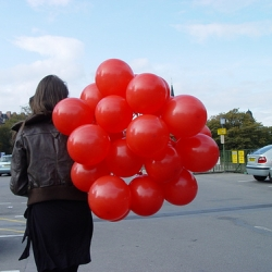 Post graduate service designer Lauren Currie takes a dozen balloons to a park in Edinburgh asking people to tie them to their favourite thing.