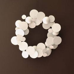 get into the holiday spirit without compromising your sense of style.  this mod wreath is so pretty.