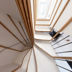 An apartment in London that resembles an intertwined bird's nest between the eaves.