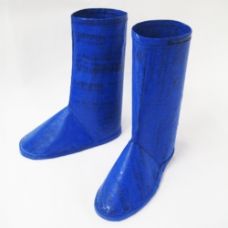 A pair of rain boots created from recycled plastic bags. Created in conjunction with the Waste for Life collective based in Buenos Aires, Argentina.