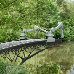 "MX3D Bridge - With our robots that can ""draw"" steel structures in 3D, we will print a bridge over water in the center of Amsterdam."