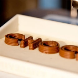 A 3D printer that uses chocolate has been developed by University of Exeter researchers - and it prints layers of chocolate instead of ink or plastic!