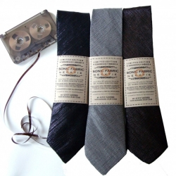 Sonic Fabric's recycled ties made from old cassette tapes still play music if you run a tape head reader over them.