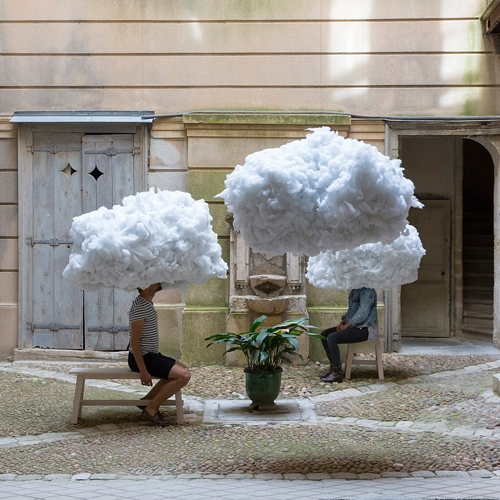 French creative duo Mickael Martins Afonso and Caroline Escaffre Faure have installed a series of floating clouds inside a hidden courtyard in Montpellier as part of The Festival des Architectures Vives 2016.