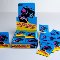 "Irreverent custom-toy maker Sucklord just released a limited edition series of collectible trading cards called ""Suckpax."" Included in one of the packs is a Golden Ticket that awards the lucky finder a one-of-a-kind custom toy designed by the man himself."