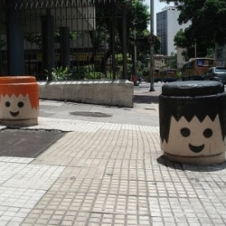 "Painted over the street parking obstacles in Rio, the Playmobil heads are a street art intervention performed by the same guy who first created the ""Urban Garden"" boxes, that are produced from graffiti spray & useless PET packages."