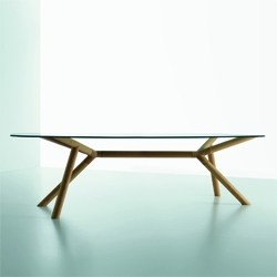 Paolo Capello's Otto is a wooden based, glass topped table designed for Miniforms that can be both used in office or living room. Its organic shaped glass top and the improbably unstable legs reinterpret our use of tables.