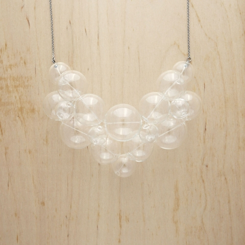 Bubbles are now wearable from Kat! These glass beads are carefully pieced together to create a fun and quirky style.