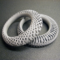 Polyoptic Bangle by Euphy is an organic yet spacy piece 3D printed in Alumide (aluminum polymer composite) by Shapeways.