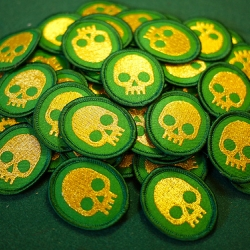 Nerd Merit Badges makes badges for nerds -- but has now come full circle, when a Girl Scout troop in California liked their skull badge so much, they asked for custom skull troop crests.
