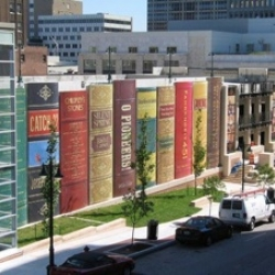 For the exterior of the Kansas City library parking lot, residents were asked to nominate books that represent the city. The winning nominations were turned into a giant bookshelf.