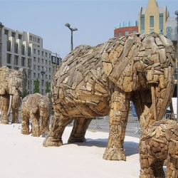 Series of wooden elephants, just like the horses made of driftwood. The elephants showed the way to the zoo of Antwerp.
