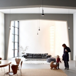A church located in Cologne was converted into a family home with 410 square meters of living space by Mathias Romm Architects.