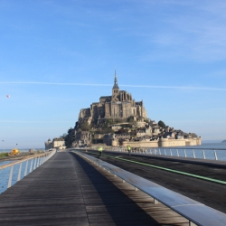 Dietmar Feichtinger Architectes unveiled a new 760-metre long bridge connecting the Normandy coastline to the medieval town of Mont Saint-Michel.