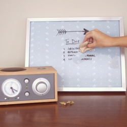 Make a dry erase board that pulls double duty as wall art when not in use.