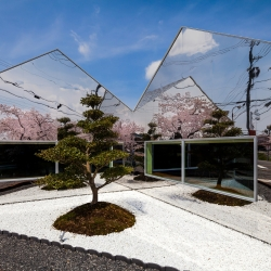 Clad with polished mirrored surfaces this café in Gifu by Japanese practice bandesign reflects the landscape surrounding creating the suggestion of a cherry tree forest.