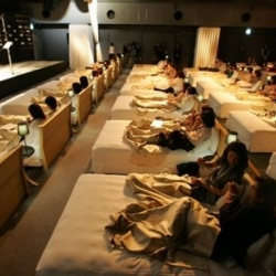 One hundred couples in Tokyo were invited to a private concert, where there's lavish beds, and unlimited Haagen-Dazs ice cream to watch a classical concert in maximum comfort.