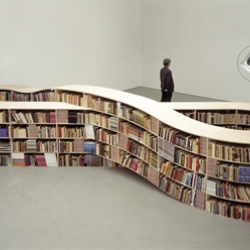 A nice bookshelf from designer Job Koelewijn modeled after the infinity symbol. But how do you get those books from the middle shelves?