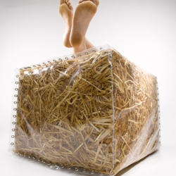 'Baley' furniture created by Gusto. Straw bales are encased within a made to measure transparent PVC cover with 104 eyelets.