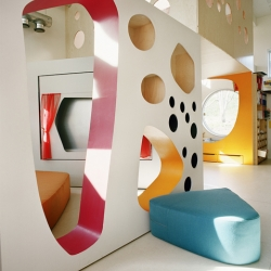 Playful kindergarten architecture by Norwegian 70°N Arkitektur. Mobile walls holds toys and furniture, opening up the floor for active children.