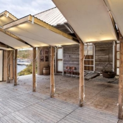 The Once and Future Boathouse. In Norway, architects dismantled a 19th century boathouse to create a new building with gull-wing-style wall of panels to open the space to the breeze.