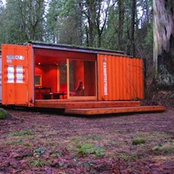 This Cargotecture cabin is already in use as a guesthouse on a rural property near Seattle. A blend of industrial and nature
