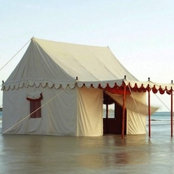 Summer like a sultan with Anthropologie's Altair Tent, featuring a mirror-spangled interior and a scalloped canopy