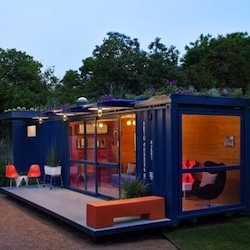 The narrow and long container (8 by 40 feet) sits on a former light industrial site, which was cleared out and fully landscaped. It now serves primarily as a guest house to the client's main house on the same property. By Poteet Architects.